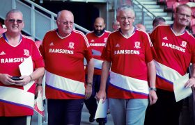 Four men on the FFIT programme wearing their Middlesbrough shirts