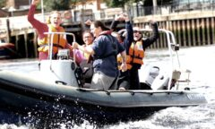 Young people cheering on a powerboat