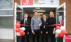 Stewart Downing, Helena Bowman and two pupils cut a ribbon