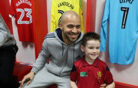 Darren Randolph smiles for a photo with a young boy