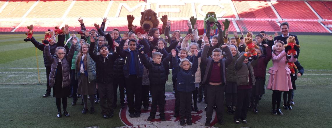 Children celebrate 100% attendance with Roary