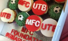 Cakes bearing the M F C and U T B wording together with text which says M F C Foundation hashtag smashed it