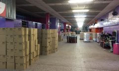Boxes of crisps donated by Greggs are stored at Middlesbrough F C's Riverside Stadium
