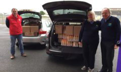 M F C Foundation staff load a van with boxes of crisps