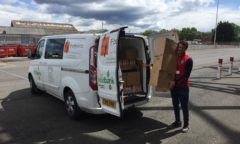 M F C Foundation's Dan helps load a van with crisps